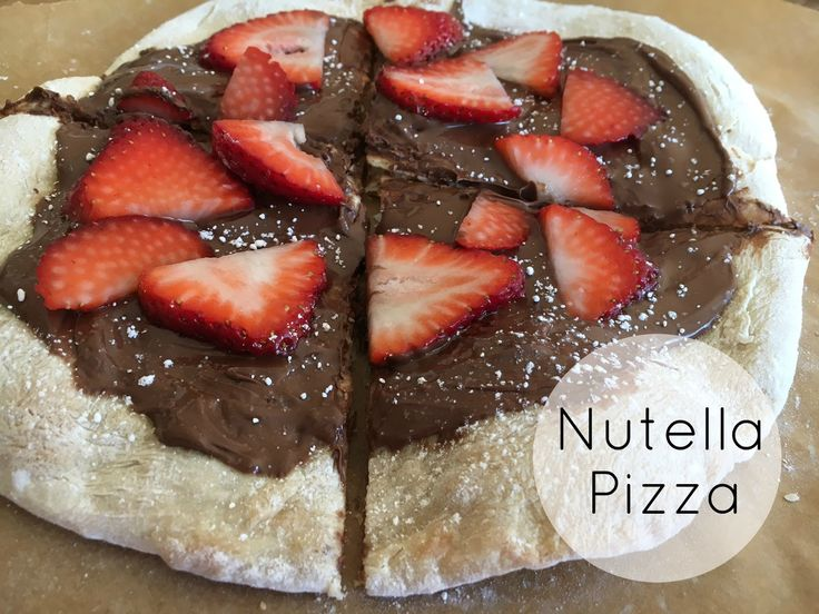 Dessert Nutella Pizza - add Nutella, sliced strawberries and powdered sugar onto warm, cooked pizza dough