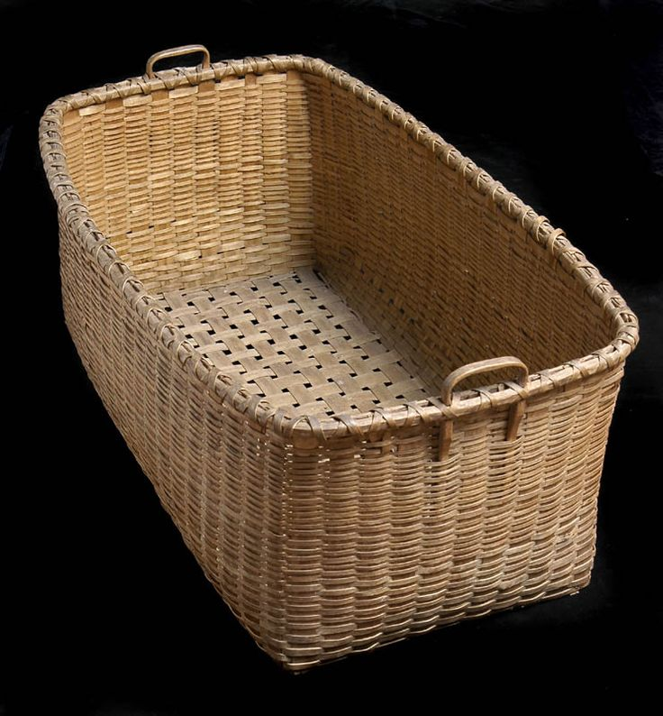 """Large shaker basket, rectangular form, black ash, double wrapped rim, finely shaped carved handles at either end, openwork woven bottom, Canterbury, NH, c. 1850, 17 1/2"""" h, 38 1/2"""" w, 24"""" d. The Doug Towle Shaker Collection. Willis Henry 9/4/5 lot 338a. Realized: $1,300 hammer."""