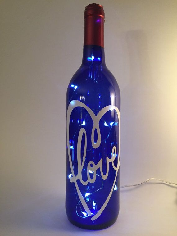 Blue lighted wine bottle LED lights. With white by WicksandWine