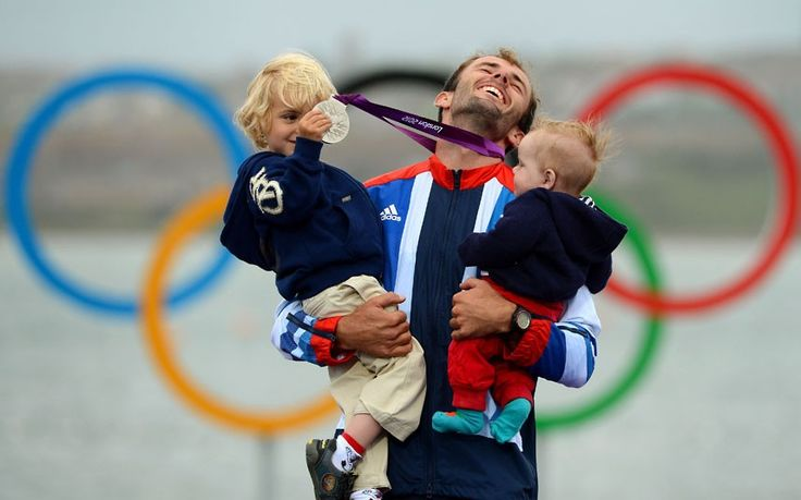 Britain's Nick Dempsey poses with his sons Thomas-Flynn and Oscar  after he won silver in the men's RS:X sailing class  in Weymouth