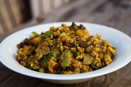 Curry rice salad prepared with brown rice, curry powder or paste, bell ...