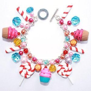 Cupcake and lollipop charm bracelet. #cute #kitsch #kawaii #pastel #goth #egl #sweets #cupcake #candy #lollipop #Katy #Perry #candyland