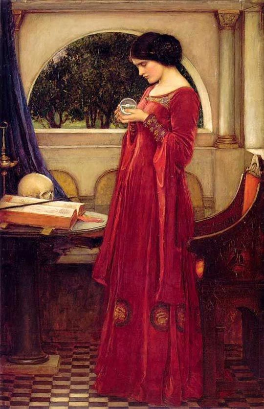 """""""The Crystal Ball"""" by John William Waterhouse RA (1849-1917) shows a young model in a red dress gazing into the ball, apparently weaving a spell with the aid of a book and a skull."""