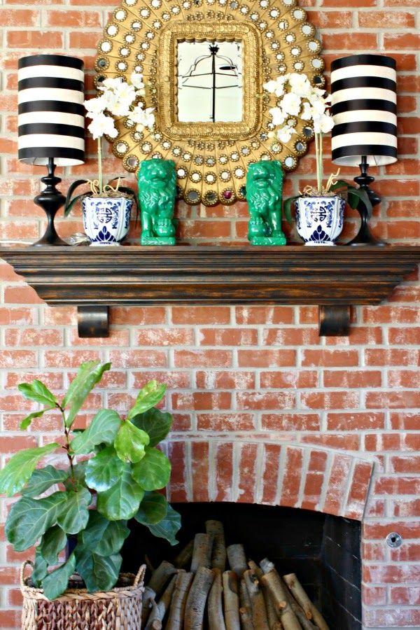 living room tour      brick fireplace      distressed black mantle      striped lamp shades      fiddle leaf fig      orchids