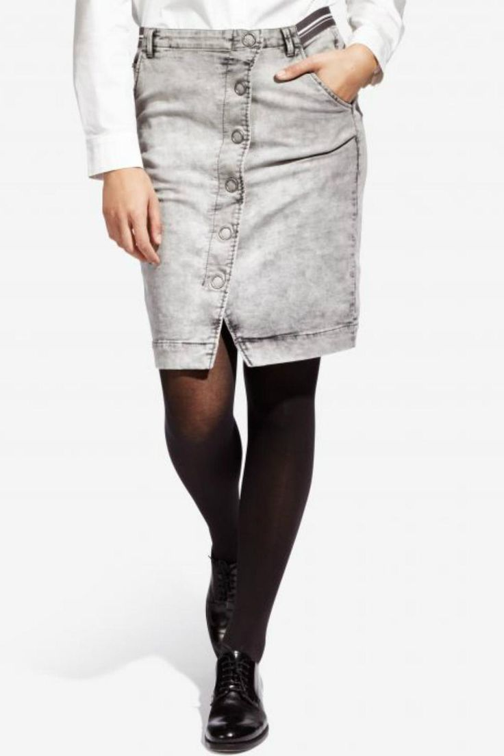 Denim skirt with asymmetrical button front is reminiscent of the 70s looks.  Pairs great with a tee or with a white button down shirt and a pullover.  Elastic waistband for comfort.  Stretch cotton. Dswenim Skirt by Sandwich Clothing. Clothing - Skirts - Denim Canada
