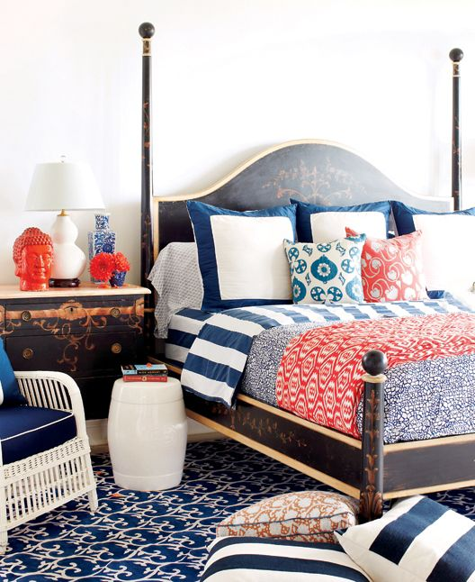 navy and coral bedroom with lots of beautiful decor items i love the charming bed side tabe and the red buddha
