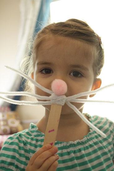 Bunny Masks: Large popsicle sticks, white pipe cleaners, and pink fluffy pom poms are the only three items needed to recreate Kailo Chic's cute bunny mask. Source: Kailo Chic