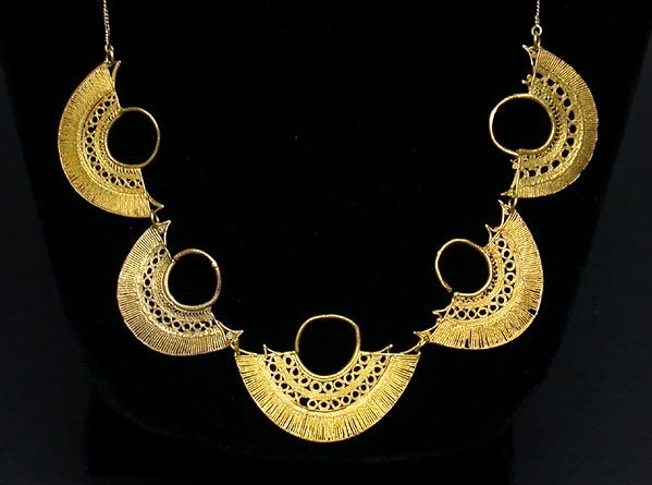 Necklace | Sam Joseph of Laguna Beach.  Composed of five gold Sinú ear ornaments, each with two stylized bird effigies, was hand-crafted into a modern wearable work of art with 18k gold links, chain, and clasp.  The ancient gold (Colombia, ca 500 - 1000 AD) is from a private collection