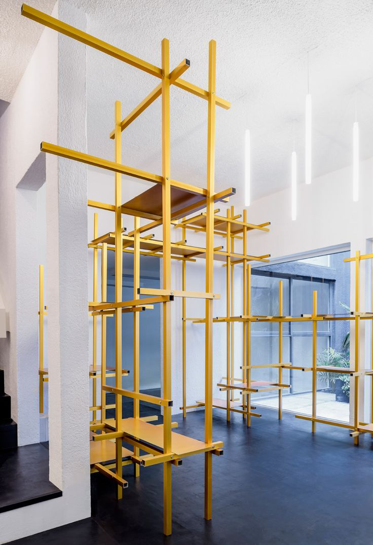 Older story » Golden aluminium framework features in Troquer fashion showroom by Zeller & Moye  Flip 9 April 2016 | Leave a comment Categories: InteriorsOfficesRetailSlideshows  Mexican firm Zeller & Moye have converted a former Mexico City residence into a studio and showroom with adjustable metal storage racks
