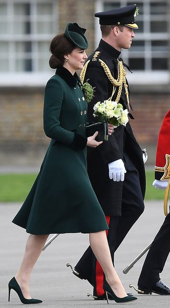 Kate Middleton Photos Photos - Britain's Prince William, Duke of Cambridge (R) and his wife Britain's Catherine, Duchess of Cambridge visit the Irish Guards, during a St Patrick's Day parade at Cavalry Barracks in Hounslow, west London on March 17, 2017. / AFP PHOTO / Justin TALLIS - The Duke And Duchess Of Cambridge Attend The Irish Guards St Patrick's Day Parade