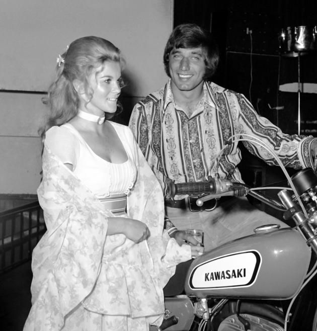 C. C. & COMPANY (1971) - Ann Margret and NFL quarterback Joe Namath of the New York Jets promote their new motorcycle movie.