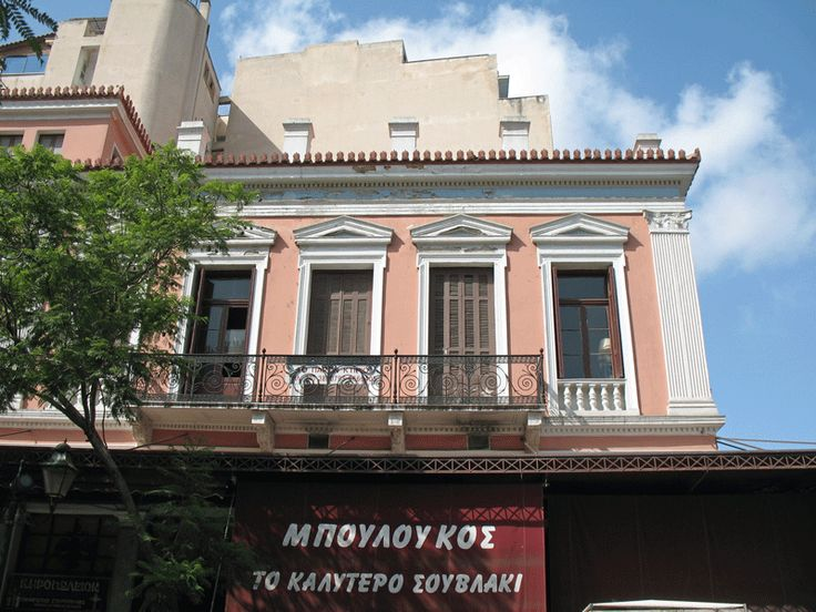 Restored neoclassical building with souvlaki shop on the ground floor in central Athens