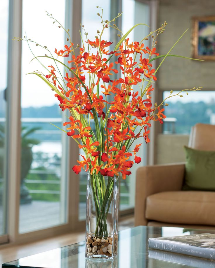 """orchid stems and wispy grass accentuated in a 9.5"""" tall square glass vase with stone and clear acrylic water"""