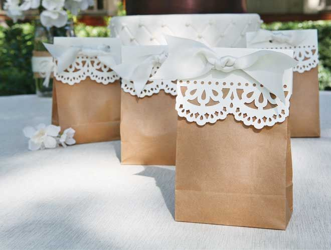 """Here's a crafty project idea that's sure to impress the cost-conscious wedding planner.  Dress up simple favor bags with ribbon and die-cut paper."""