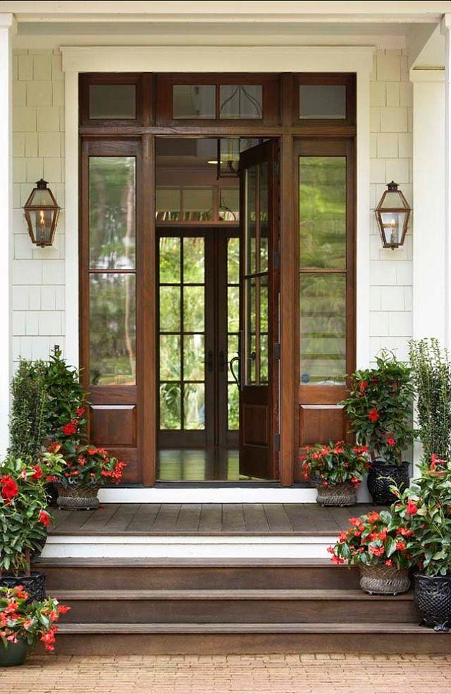 This is a mahogany door with a walnut stain. Door Measurements: 3′ door with 12″ side lights on either side.