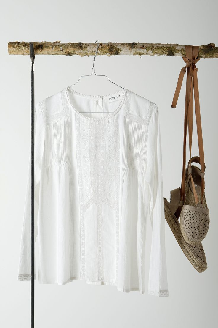 Boho basics: White and light flowy blouse and natural lace-up espadrilles shoes from Spanish womenswear brand, Indi & Cold