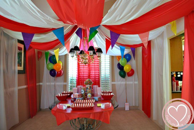 Indoor circus carnival tent. Use plastic table cloths and thumb tacks.