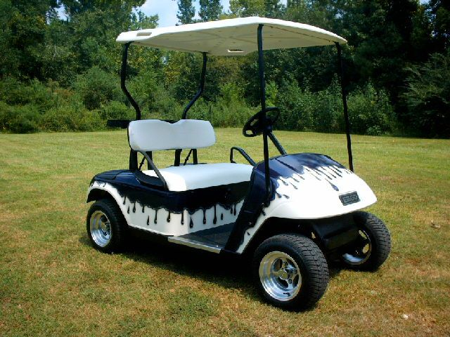 "This is a Used E-Z GO Golf Cart with a custom painted body (Purple Drip Pattern), 10"" polished aluminum rims on low profile tires, new seat covers and a 4hp high speed electric motor.  Very Cool Golf Cart!  Visit www.GolfCarts-USA.com to see more like this and to find golf cart dealers in your area.  #CustomGolfCarts"