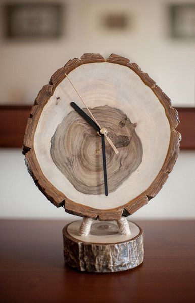 Walnut clock by WoodenLand. Clock made from a patch of trees walnut, hand ground, covered with acrylic varnish and wax.