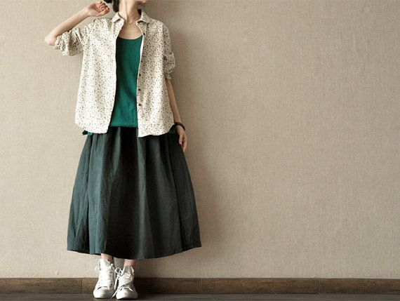 Cotton and linen layers.  T shirt, short sleeved button down shirt and gathered skirt.