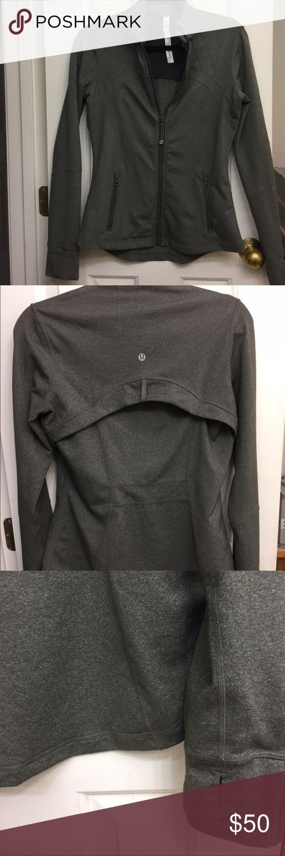 """Charcoal sage Lululemon define jacket. Excellent condition Lululemon long sleeve jacket in charcoal sage color ( smokey sage? Lol) very slight pilling in underarm area- hard to see, I only noticed when I was inspecting the seams to measure length. Zipper garage at chin and thumb holes in cuffs. Only visible sign of wear is slight wear on paint of zippers on pockets. Back flap covers racer back vent. Sleeve 27"""", length 25"""", 18"""" chest. Quite stretchy. lululemon athletica Tops Sweatshirts…"""