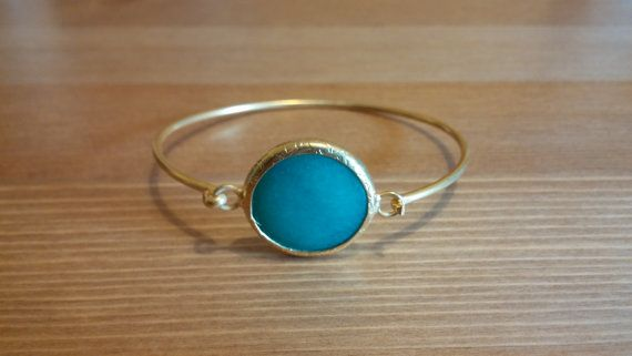 a plated bracelet with blue stone by toocharmy on Etsy