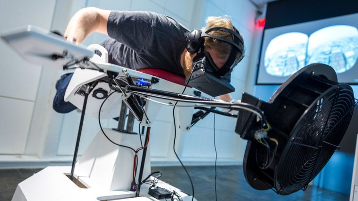 We strap on an Oculus Development Kit and mount Birdly, a full-motion virtual reality rig that simulates flying. It's one of the most awesome and intuitive V...