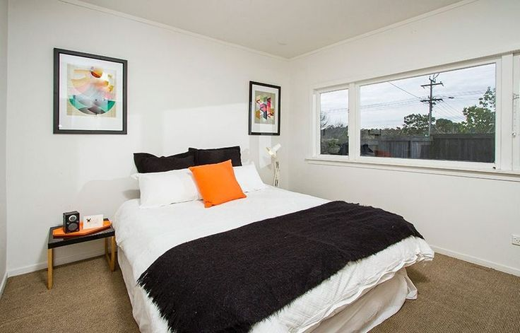 #Funky bedroom #inaluxe art prints #black, white, orange. Staging by Places and Graces. Photo courtesy of @Harcourts State Office