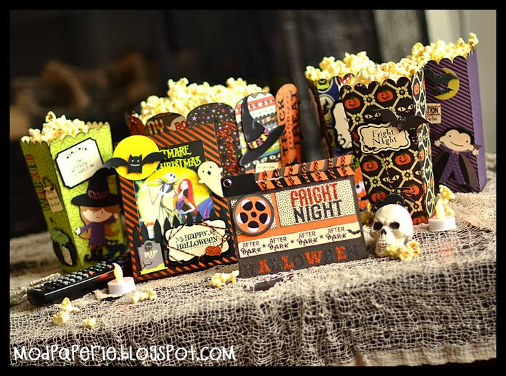 Halloween movie night idea. the popcorn holders are to die for. so cute. lets find cute popcorn holders @Estela Ruezga