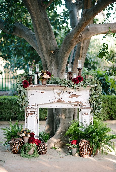 An aamazing ceremony altar! A simple and rustic fireplace with floral design by Art With Nature Design.