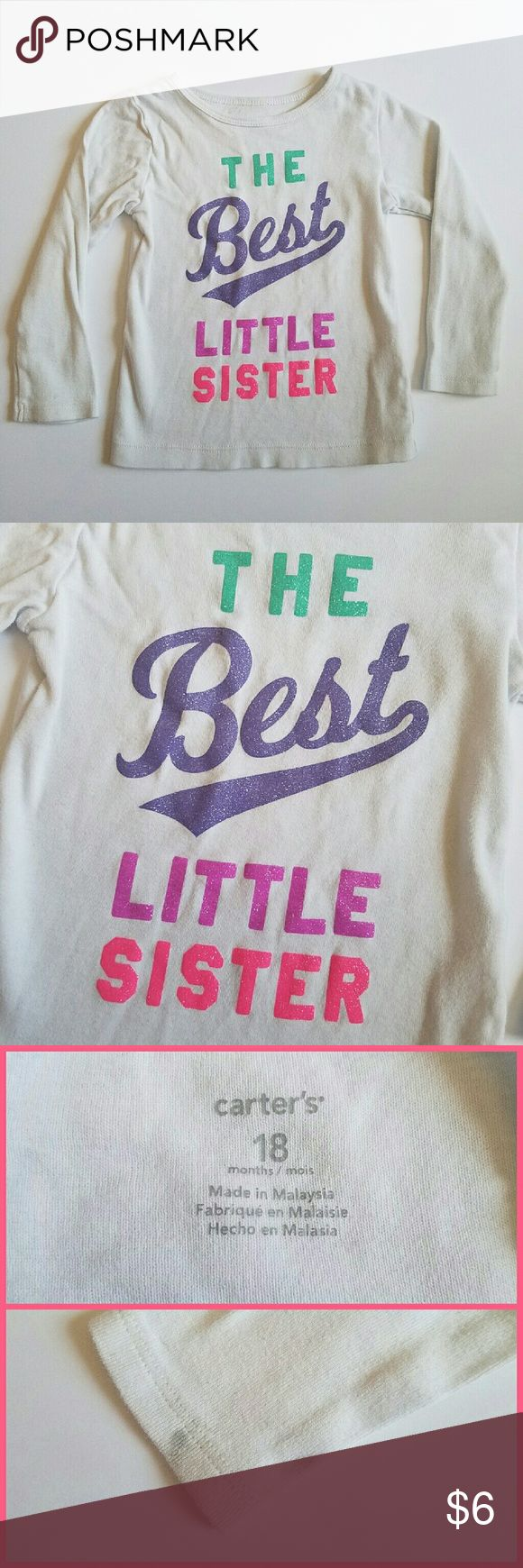 """Carter's Sister Top Cute long sleep top from Carter's. Says """"the best little sister"""" in glitter. There is a spot on the right sleeve as pictured, unsure if it's removable. Size 18 months. Carter's Shirts & Tops"""