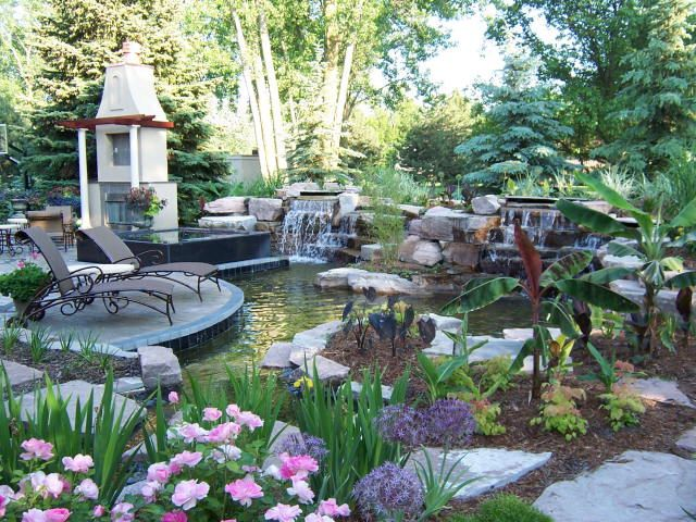 Backyard Retreat With Paver Patio Koi Pond Waterfalls
