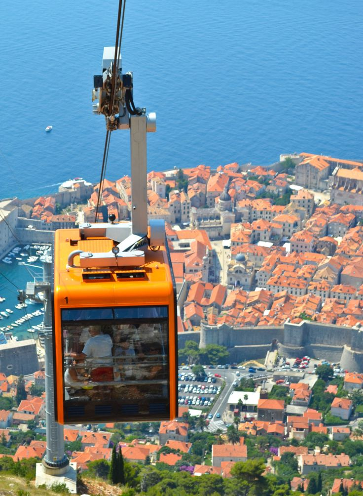 Cable Cars of Dubrovnik, Croatia. October 2012 we took one of these cable cars to the top where there was a beautiful outdoor cliffside restaurant where we ate lunch with a spectacular view of Croatia and the ocean which you we could see for miles! Awesome!