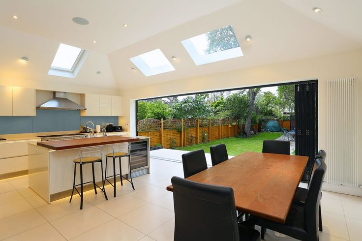An exciting balance of contemporary and traditional features are displayed with a large crown roof extension to this detached property.