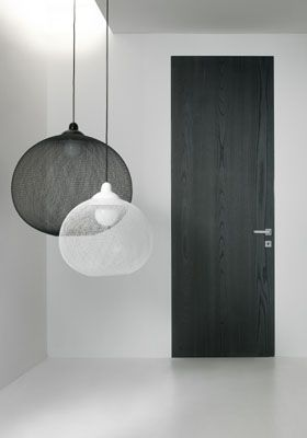 Moooi non-random lights. Segno Flush frameless door. The frame is integrated in the drywall. Nice.