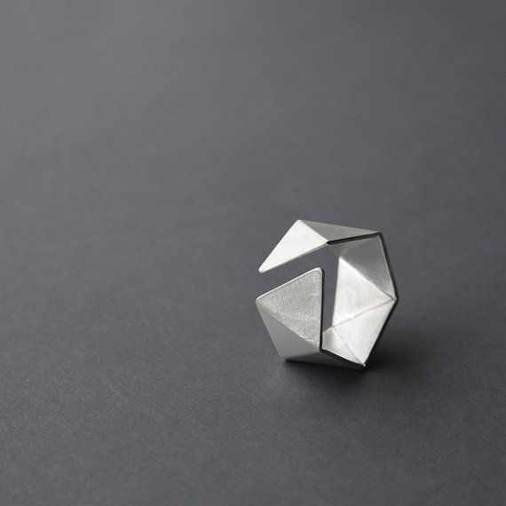 This geometric ring is handcrafted of sterling silver. It comes in two different finishes. The faceted surface makes it reflect beautifully with light.