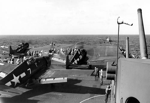 """Fighters F6F «Hellcat» (Grumman F6F Hellcat) of fighter squadron VF-16 taking off from the deck of an aircraft carrier """"Lexington» (USS Lexi..."""