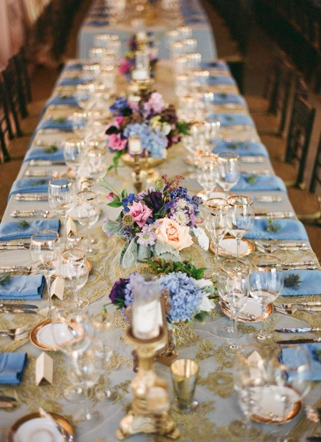 Deck out your wedding reception tables in a blue and gold color scheme.