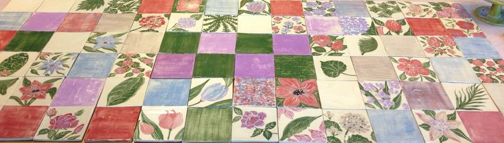 Hand painted tiles by Aline D