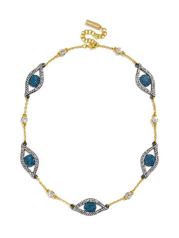 A whimsical evil eye motif stands out with brilliant blue stones and steely hematite on a delicate gold chain punctuated with crystals.