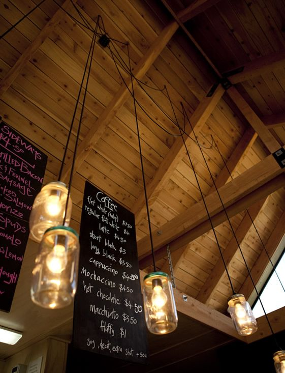 Menus look best on blackboards written with a chalky texture :)    Love the hanging lamps as well!    Wood always adds to the atmosphere..