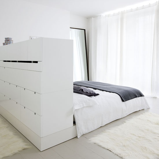 Drawers behind the bed. Can also be changed into an accessory and make up station with a tall mirror.