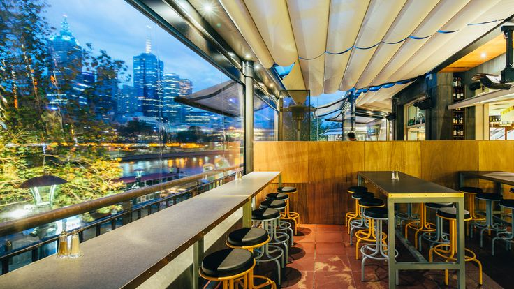 An expansive art deco-inspired dining hall faces out to the sweeping city views of the Yarra River and iconic Flinders Street station. WOW Architectural created a range of customised steel frames to meet the unique brief