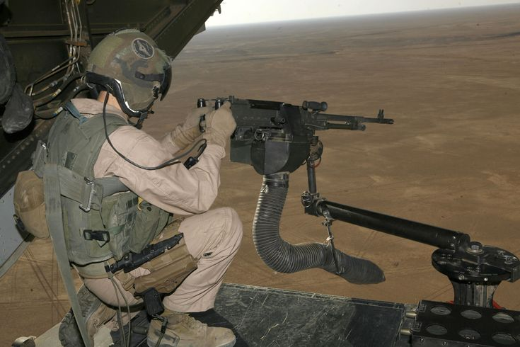 M240 machine gun mounted on V-22 loading ramp with a view of Iraq landscape.