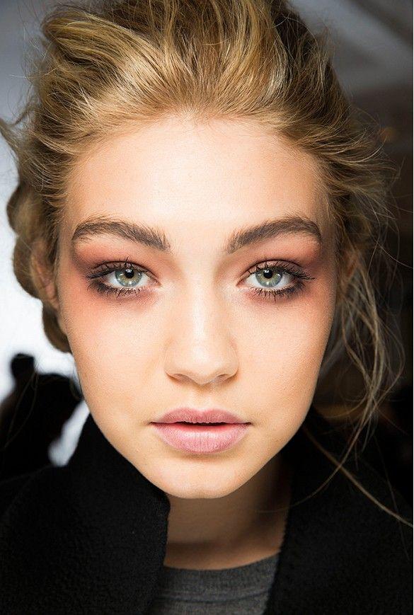 Gigi Hadid's pulled-back updo + fluttered, flirty lashes
