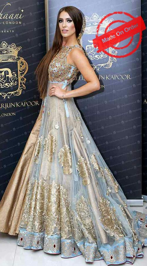 Glamorous Golden And Sky Blue Net Designer Replica Anarkali Cum Lehenga BP1720 Get a very beautiful look in this lovely color long trail choli lehenga style and set a new fashion trade mark. Perfect attire for a wedding. This is a custom made design which can be made in any color and size.
