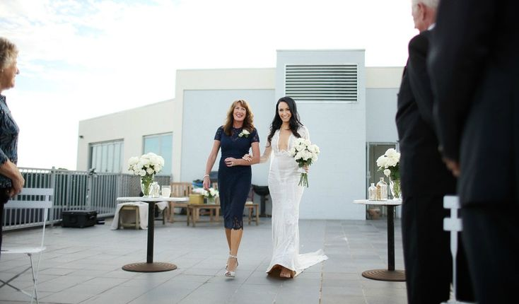 Processional joy.  Nat and Pete's rooftop elopement in Melbourne.    Melbourne Celebrant Sally Hughes.  Image by Warrenphotography