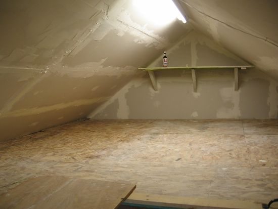 Attic renovation - we added drywall and fluorescent lighting to turn this crawlspace into more usable storage. #GElighting