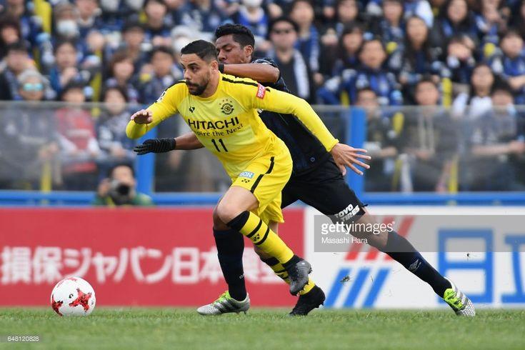 Diego Oliveira of Kashiwa Reysol controls the ball under pressure of Fabio of Gamba Osaka during the J.League J1 match between Kashiwa Reysol and Gamba Osaka at Hitachi Kashiwa Soccer Stadium on March 5, 2017 in Kashiwa, Chiba, Japan.