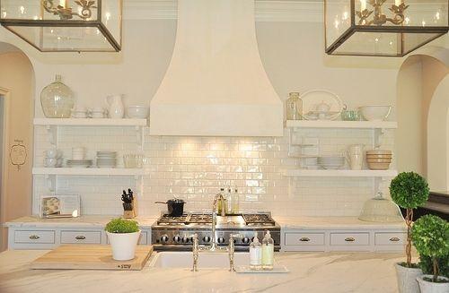 beautiful white kitchen with subway tile backsplash and open shelves